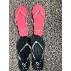 2 pairs of Justice flip flops